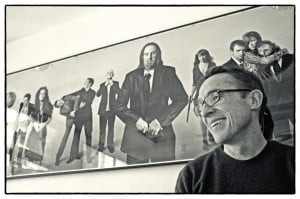 John yorke infront of picture of Shameless cast channel 4 Black and white