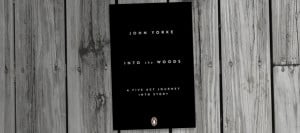 Picture of Into the woods book on a wooden table black and white