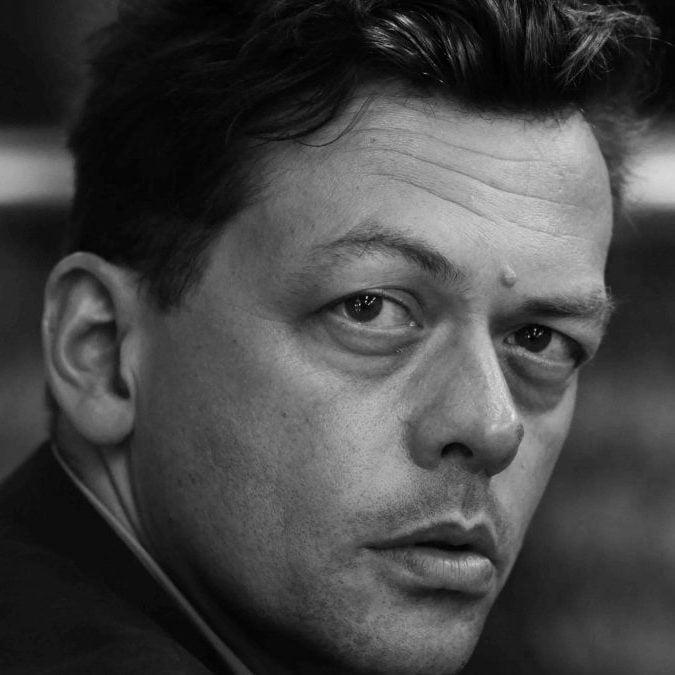 Black and white headshot of Professor Simon Stephens