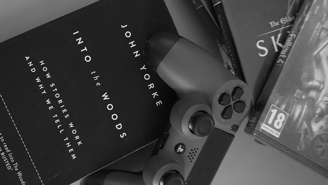 PlayStation controller on top of a copy of John Yorke's Into the Woods article feature